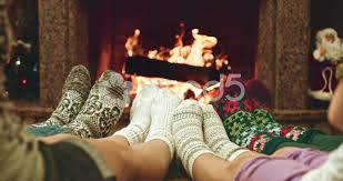 100 Foot Cozy Feet In Woolen Socks Warming By Cozy Fire Family With Two Kids Near