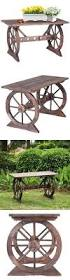 Patio Plant Stands Wheels by Wagon Wheel Bench Wagon Wheel Creations Pinterest Wagon