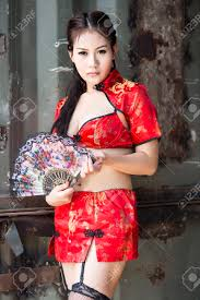 chinese woman red dress traditional cheongsam stock photo