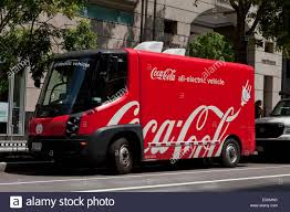 Electric Coca Cola Delivery Truck - USA Stock Photo: 72501784 - Alamy Driving The Green Mit News Pluginrecharge Shannon Loves Her Electric Truck At Fritolay Sa Recycling Takes Delivery Of Two Allelectric Yard Trucks Www 1912 Detroit Newspaper Delivery Truck Dpl Dams Fedex Testing Ev Trucksthe Earthy Report Delivering An Electric Shock To Smog Volkswagen Bus Volkswagens New Edelivery Will Go On Sale In 20 Boulder Vehicle Wikiwand Fistaples Hybrid Dieselectric Was 2010 8910jpg North America Owns One Largest Commercial Fleets Vws Bold Investments Cover Trucks And Buses As Well Cars Ups Wkhorse Design Van Eltrivecom