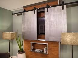 Hidden Flat Screen TV Wall Cabinet Made Particle Wood In Brown Color Having Chrome Steel