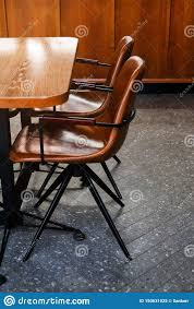 Wooden Table And Leather Chairs Or Chairs, In A Cafe, Office ... Rd9582 2 Vintage Samson Folding Chairs Shwayder Bros Samso Amazoncom Wooden Chair Modern Ding Natural Solid Leather Home Design Set Of Twenty Four Bamboo Red Home Lifes French Directors In Beech 1960s Antique Armchair With Shadows Stock Photo Luggage On Edit Folding Chair Restorno Chairsantique Arm Chairsoccasional Pair Armchairs In Wood And Brown Galerie