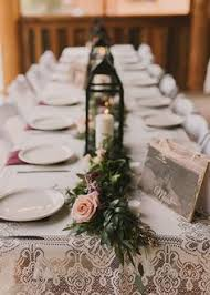 Romantic And Rustic Table Design With Lanterns Garland