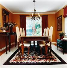 Dining Room Black Metal Chandeliers Lamp Over Brown Wooden Set Connected By Orange Wall