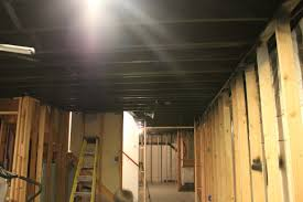 Hanging Drywall On Ceiling Joists by Basement Remodel With Painted Exposed Ceiling