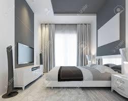 luxuus schlafzimmer mit einem großen fenster auf dem boden in einem modernen stil grau inlays an der decke und an der wand an der wand des