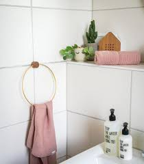 bathroom with knit towels by liewood and towel holder by