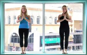 And Alexandria Duval Known As Alison Ann Dadow Before They Changed Their Names Stand In The Window Of Yoga Studio West Palm Beach Fla