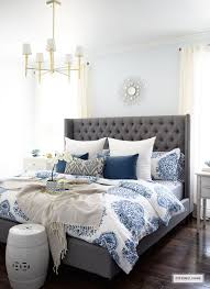 Gorgeous Blue And White Bedroom Featuring Bedding Paired With Global Inspired Textiles