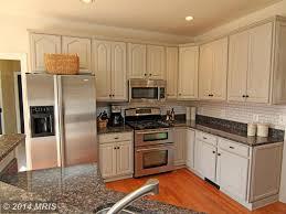 traditional kitchen with subway tile hardwood floors baltic