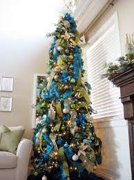 Blue Green And Silver Are Predominant Colors Used For Decorating This Christmas Tree The Ribbons Placed Horizontally Or Tied In A Bow
