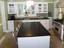 White Cabinets Dark Granite by Kitchen With White Cabinets And Dark Countertops Home Design Ideas
