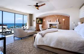 View In Gallery Spacious Bedroom With A Modern Seating Nook Next To The Fireplace