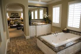 Paint Color For Bathroom With Brown Tile by 24 Master Bathrooms With Soaking Tubs In The Center