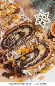 Homemade Poppy Seeds Cake And Spruce Branches On Rustic Board Dessert Decoration For Christmas