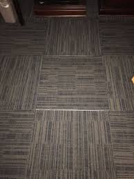 separated floor tiles with sticky showing picture of