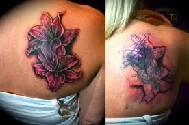 Black Ink Lily Flowers Cover Up Tattoo On Right Back Shoulder