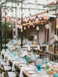 A Rustic Look With Edison Lightbulbs Hanging From The Structure Of Clear Wedding Tent In
