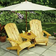 neat adirondack chair table umbrella set for over looking the barn