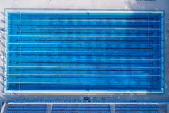 Top View Bird Eye Of Swimming Pool With Marked Lanes And Starting Platform