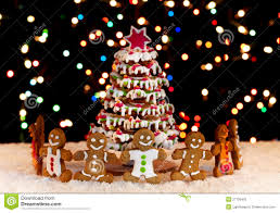 Christmas Tree Meringues by Happy Gingerbread People Around The Christmas Tree Royalty Free