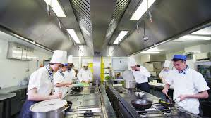 cooking chef cuisine professional chef in a commercial kitchen cooking flambe style in