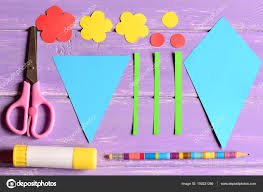 Making Paper Crafts For Mothers Day Or Birthday Step Cut Details Scissors Glue Stick Flowers Templates Pencil On A Table Set Childrens Art