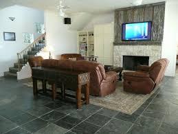 Black Slate Flooring In Living Room With Brown