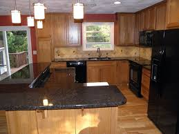 interior black quartz countertop kitchen with light brown wooden