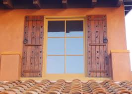 Decorative House Shutters With Designs