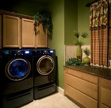 a traditional style laundry room with granite countertops and