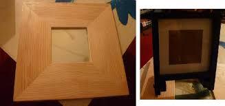 photo un miroir en bois ikea et un cadre photo format