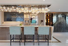 20 shiny glass pendant lights giving aesthetic glow in the kitchen