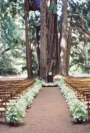 This Woodsy Wedding Aisle Was Created With Plenty Of Lush Greenery Verbena And Sedums