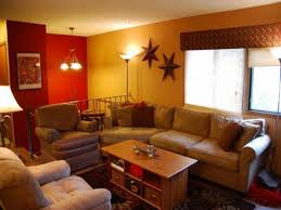 Bedroom Yellow Red Wall Paint With Glass Windows Plus Brown Sofa