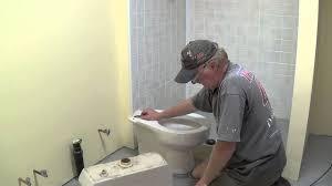 Basement Bathroom Ejector Pump Floor by Diy Basement Bathroom Part 10 Installing Toilet Youtube