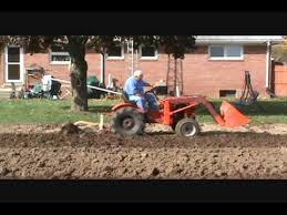 Power King Tractor 1980 Model 1618 plowing garden