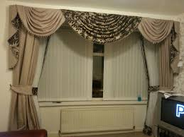 stunning swag curtains for living room choosing swag curtains