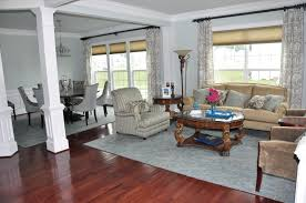 White Pillars Design For Living Room Dining Combo With Wood Flooring And Glass Window Also
