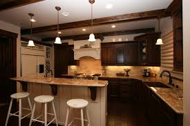 Home Design Decorating The House With A Beautiful Kitchen Equipped Table And Chairs Chandelier Then Add Brown Cupboards Sink Right