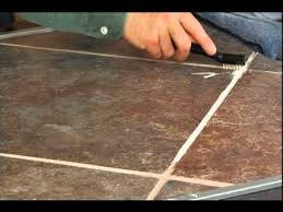 getting tile grout clean using an acrylic resin clip