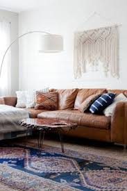 Brown Couch Living Room Colors by Boho Chic Living Room Makeover Finding The Perfect Rug Boho