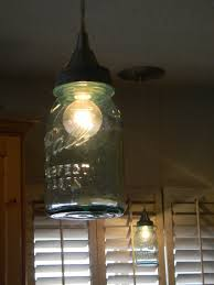 turn a jar into a pendant light i d like these for the