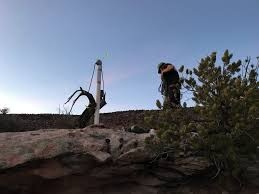 Michael Prepares To Place Stakes 660 Feet From Their Monument Per The Requirements Of A