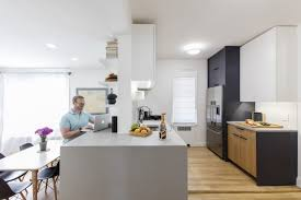 Above Joel And Erics Kitchen Is Brought Into The Social Fold With Adjacent Living Room By Building A Countertop That Unifies Both Spaces Work