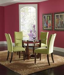 Romantic Green Dining Room Using 4 Uphostery Fabric Cover Armless Chairs Set With Red Wall Painted Interior