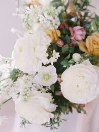 Winter wedding flowers in peach and white with italian ranunculus
