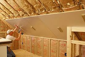 rigid foam insulation being hung from sloping ceiling using small