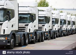 Freight Transportation Trucks Parked In A Row Stock Photo: 279031245 ... Toyota Project Portal Hydrogen Fucell Semi Is Ready To Haul Video Moving Freight Semi Trucks With Product Of Ireland Caption On Out Of Road Driverless Vehicles Are Replacing The Trucker Freight Nestle Logo Loading Or Unloading At Transport Transportation Blue Truck Trailer In Mack Trucks 1 Gotta Love Macks Disnctive Sound Bulldog Power Hollywood Llc Truck Paterson Global Foods Pgf Brokers Load Boards Direct The Future Trucking Uberatg Medium Industry United States Wikipedia