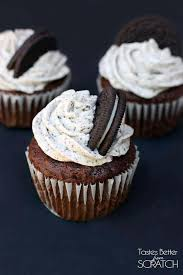 Three Chocolate Cupcakes With An Oreo Bottom Crust And Topped Cream Frosting
